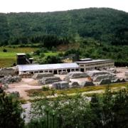 Utbygging i tre etappar. Fabrikken vart i 1968 flytta til Bruland for å kome nærmare sandtaket der. Seinare utvida i 1974 og 1986.
